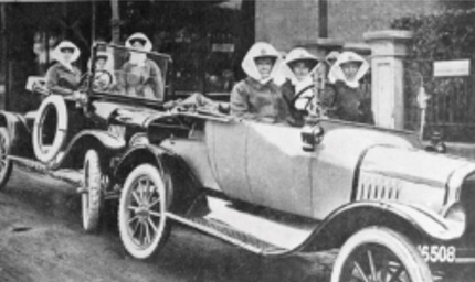 Historic image of nurses from the Melbourne District Nursing Service (now Bolton Clarke) in two cars